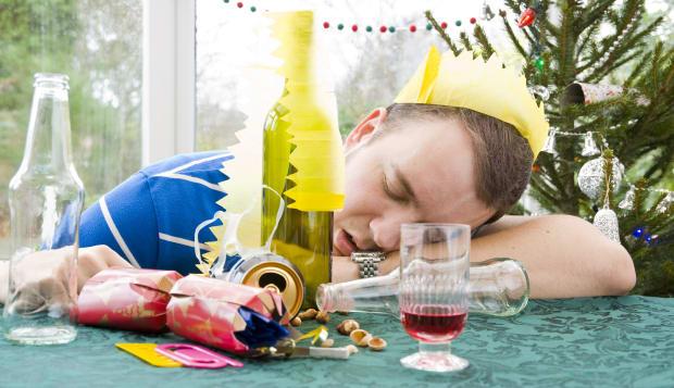 man asleep with head on table...