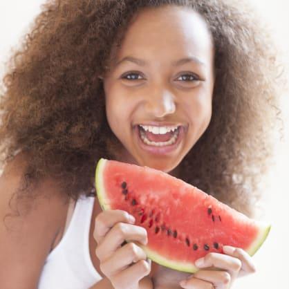 Teenage girl eating watermelon