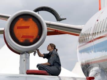 A mechanic checks the engine of a VFW 61