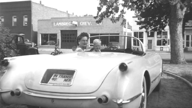This family photo which was provided by Jeannie Stillwell, daughter of Ray Lambrecht of the Lambrecht Chevrolet car company in Pierce, Neb., shows Mildred Lambrecht, wife of Ray, and their son Mark in a brand new 1953 Corvette, in front of the dealership. In September 2013, bidders from at least a dozen countries and all 50 U.S. states will converge on Pierce, a town of about 1,800 in northeast Nebraska, for a two-day auction that will feature about 500 old cars and trucks, mostly Chevrolets that went unsold during the dealership?s five decades in business. About 50 have fewer than 20 miles on the odometer, and some are so rare that no one has established a price. The most valuable could fetch six-figure bids. (AP Photo/Jeannie Stillwell Family)