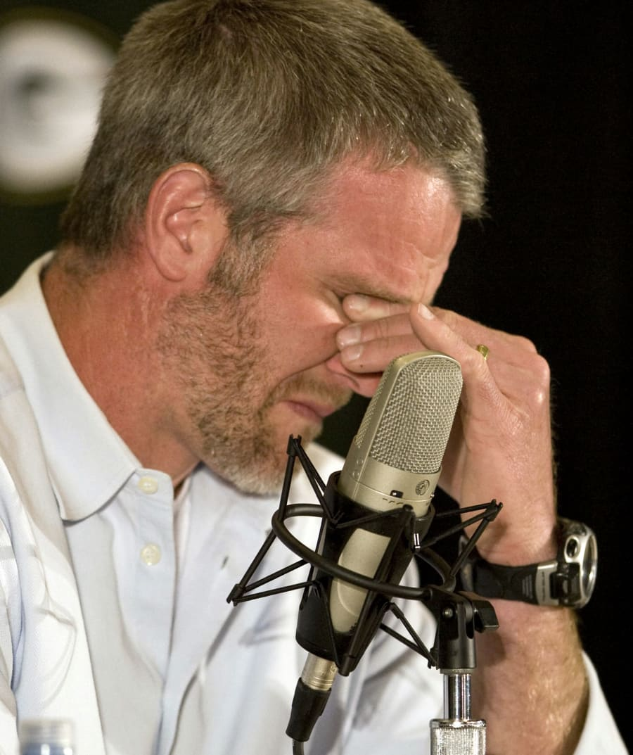 Brett Favre, the former Green Bay Packers' quarterback, holds back the tears after announcing his retirement...