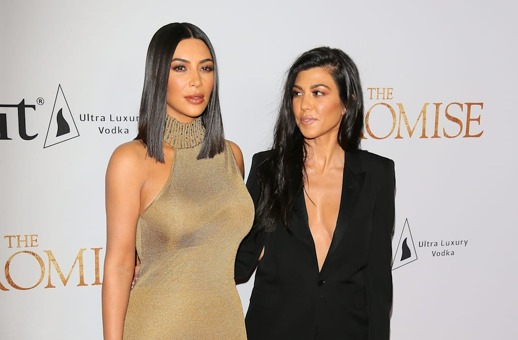 Kim and Kourtney Kardashian rock colorful bikinis