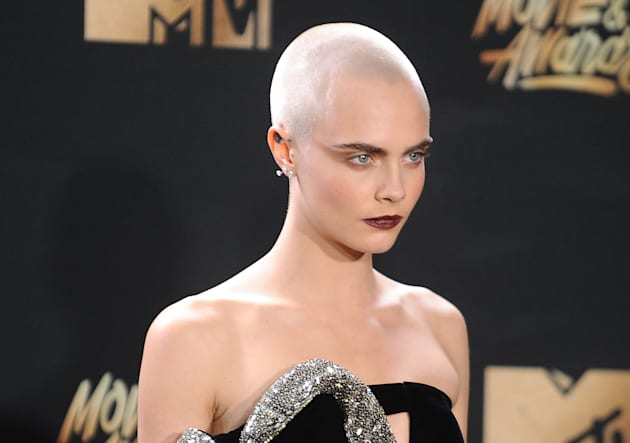 Cara Delevingne poses in the press room at the 2017 MTV Movie and TV Awards at The Shrine Auditorium...