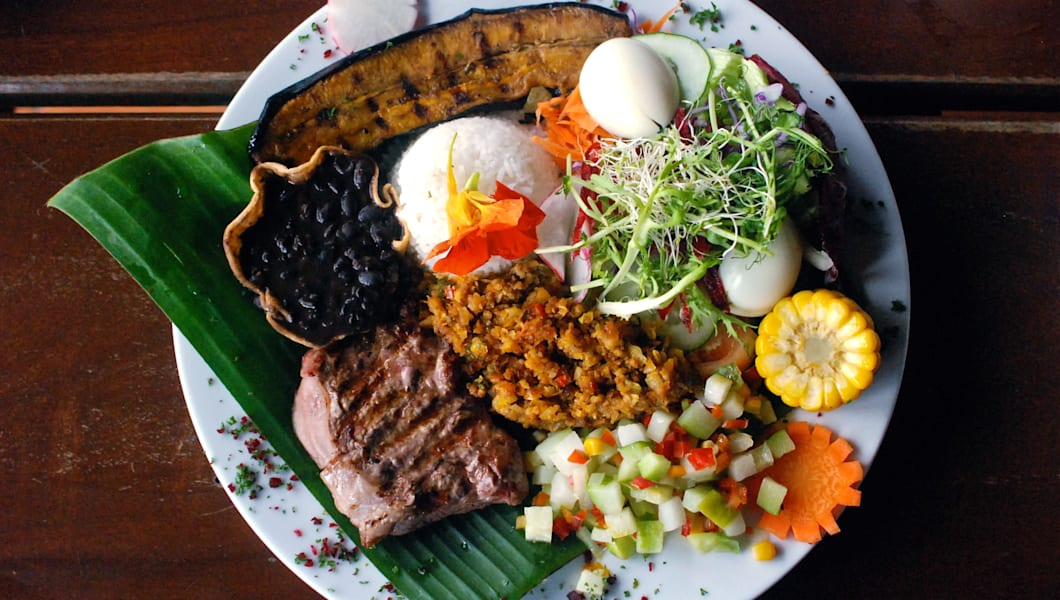 traditional plate in Costa Rica, called 'Casado'. It's composed by rice, beans, steak, banana egg, corn and salad.