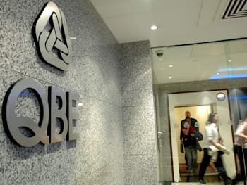 The sign for QBE Insurance Group Ltd. is displayed in the fo