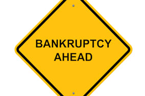 caution sign   bankruptcy ahead