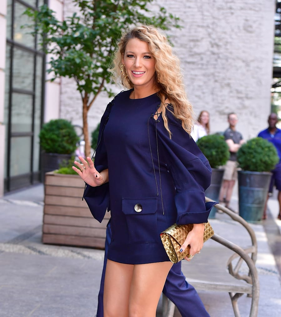 On June 22 Lively hit the streets of Manhattan in a long sleeve navy mini dress. With legs like that...