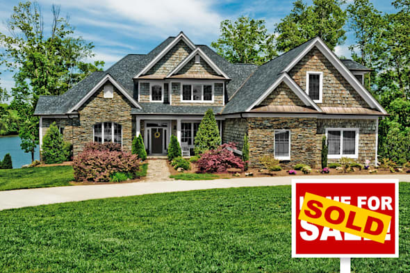 beautiful home with sold sign...