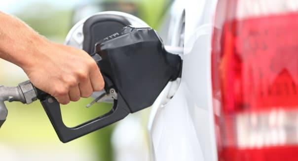pumping gas at gas pump....