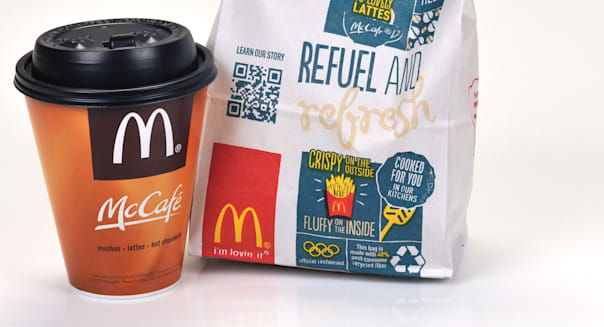 Small McDonald's cup of Coffee with  MCdonald's food bag. USA