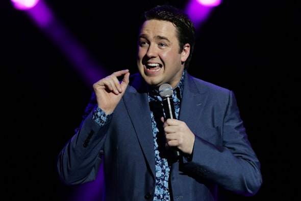 Jason Manford performing on stage