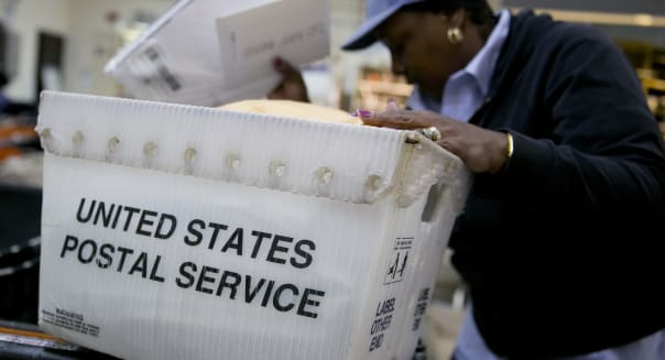 Online shoppers help cut U.S. Postal Service first-quarter loss