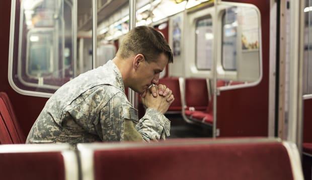 Soldier alone in train