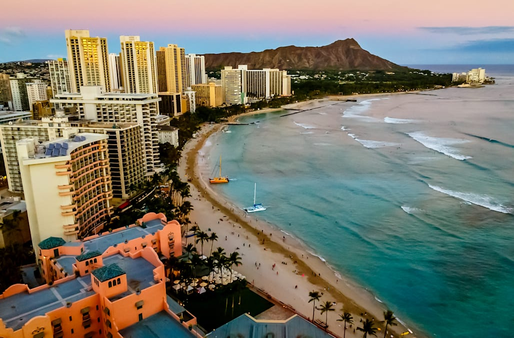 View of Waikiki Beach and Honolulu Skyline at sunset