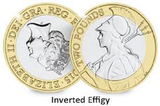 The inverted effigy coin
