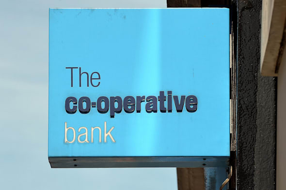File photo dated 07/08/13 of a Co-operative Bank branch sign as the business has reported a �1.3 billion annual loss today as it warned its legacy issues will continue to hit its financial performance for some time. PRESS ASSOCIATION Photo. Issue date: Friday April 11, 2014. See PA story CITY Coop. Photo credit should read: John Stillwell/PA Wire