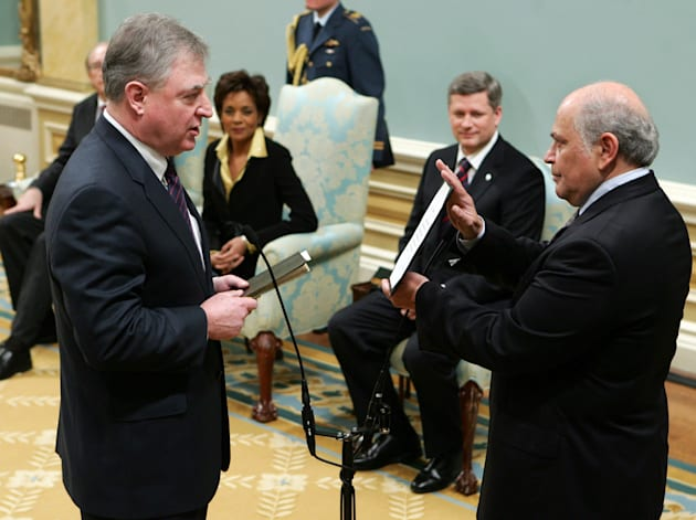 David Emerson is sworn-in as international trade minister as former prime minister Stephen Harper and...