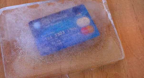 frozen credit card in a block...