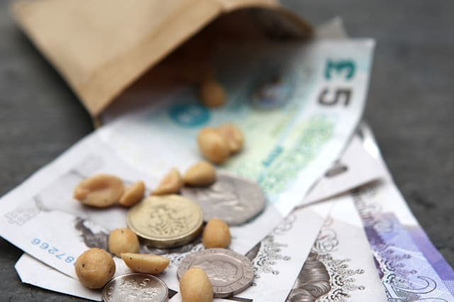 British Currency and Peanuts in a Pay Wage Packet