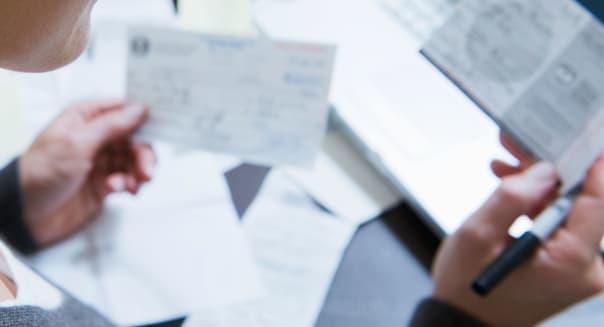B8W8F3 Woman Sorting Bills Woman|Sorting|Bills; bills|organization|personal; finance|sorting|expenses|financial; documents|finan