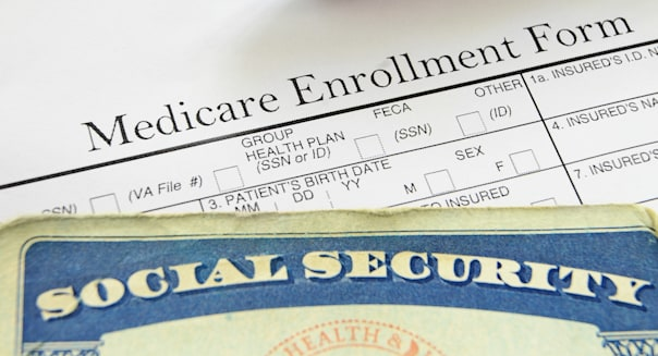 Social Security card and Medicare enrollment form; Shutterstock ID 115761634; PO: DF-112612-gallery bill; billing; card; claim;