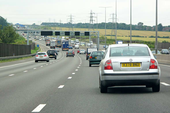 LONDON, UK - JULY 20: Heavy traffic on british motorway M1 on July 20, 2012, London, UK. The M1 is a north-south motorway in Eng