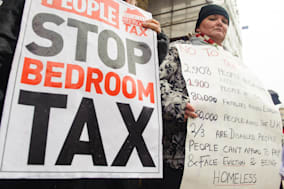 File photo dated 16/03/2013 of protesters taking part in a demonstration against the government's proposed 'Bedroom Tax', which would cut benefits to people with a spare room, as disabled people are taking their legal challenge to the Government's so-called