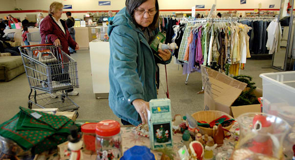 Lori Bowen of North Augusta does some holiday shopping at the Salvation Army Thrift Store in Augusta, Ga. on Friday, December 10
