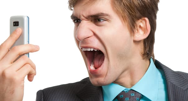 Angry business man screaming on cell mobile phone, portrait of young handsome businessman isolated over white background, concep