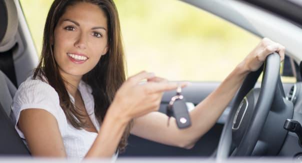 Beautiful Woman holding up Car Key