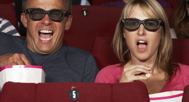Couple Watching 3D Film In Cinema