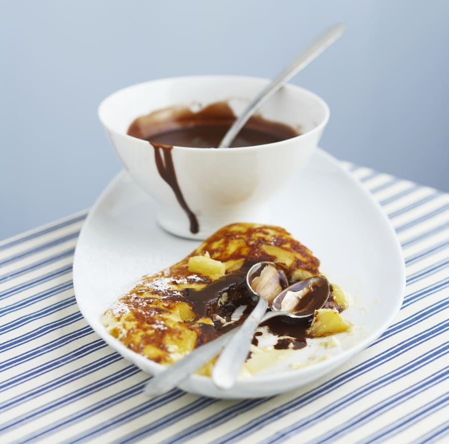 Sweet omelette with chocolate sauce and banana.