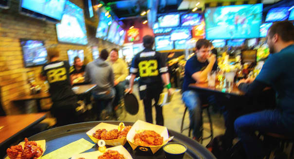 March 20, 2014 - Minneapolis, Minnesota, U.S. - Wings headed for customers at Buffalo Wild Wings at the University of Minnesota