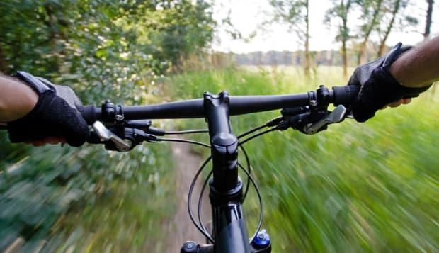 Bicycle rider on mountain bike, motion blur
