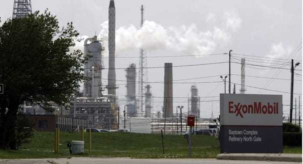 Exxon Energy (FILE - In this April 16, 2010 file  photo, steam rises from towers at an Exxon Mobil refinery in Baytown, Texas. E