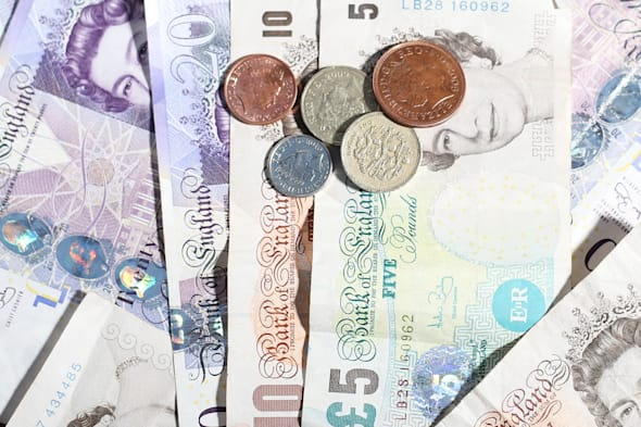 Embargoed to 0001 Thursday December 12File photo dated 18/03/13 of money as the UK downturn is finally expected to be left behind next year as the size of the economy surpasses its pre-recession peak, according to a new forecast upgrading prospects for growth. PRESS ASSOCIATION Photo. Issue date: Thursday December 12, 2013. The prediction from the British Chambers of Commerce (BCC) brings forward the likely date to the third quarter of 2014. It would mark the first time that UK gross domestic product (GDP) has climbed back to the peak it reached in the first quarter of 2008. See PA story ECONOMY GDP. Photo credit should read: Lynne Cameron/PA Wire