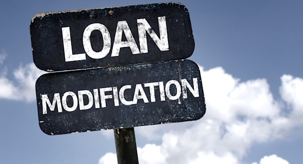 loan modification sign with...