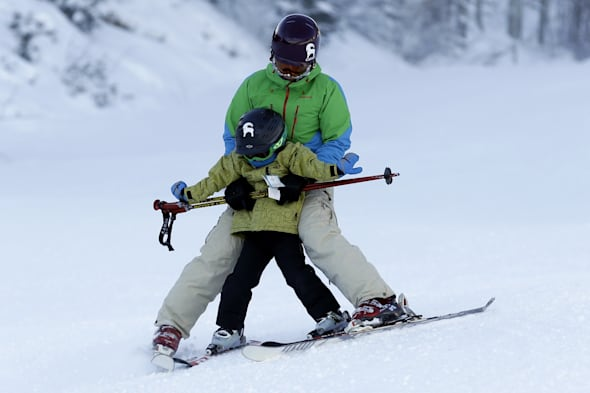 Adult skiing with a child
