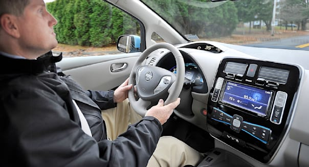 Jim Gailey recharges his department's new Nissan Leaf