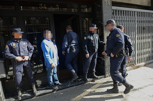 NOTE: IMAGE PIXELATED AT THE REQUEST OF THE POLICEOfficers from City of London Police and their Spanish counterparts from the Policia Nacional raid a business property in Barcelona, Spain, to execute a warrant in a joint operation as they target a boiler room investment fraud operation. PRESS ASSOCIATION Photo. Picture date: Tuesday February 25, 2014. See PA story POLICE Fraud. Photo credit should read: Anthony Devlin/PA Wire
