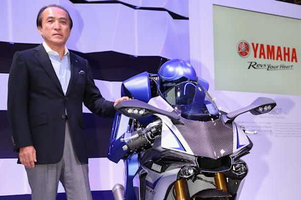 TOKYO, JAPAN - OCTOBER 28:  President, CEO and Representative Director of Yamaha Motor Co., LTD Hiroyuki Yanagi unveils the MOTOBOT at the press conference during the Tokyo Motor Show 2015 at Tokyo Big Sight on October 28, 2015 in Tokyo, Japan. The Yamaha booth displays a 20-model array of concept and production models, including six world premiere models and one Japan premiere model.  (Photo by Ken Ishii/Getty Images for Yamaha Motor Co., LTD) *** Local Caption *** Hiroyuki Yanagi