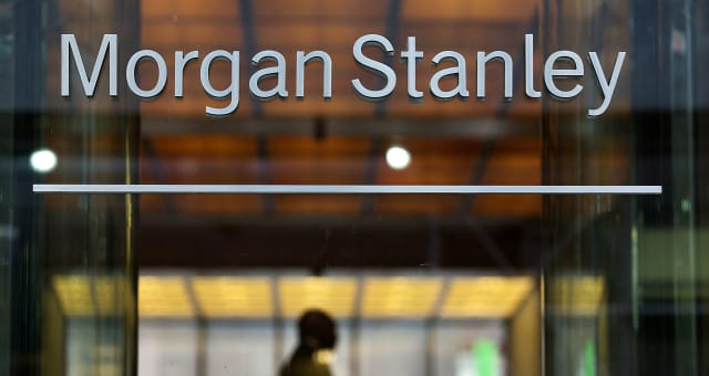 Morgan Stanley signage is displayed outside of the company's headquarters in New York, U.S., on Thursday, July 19, 2012. Morgan Stanley reported a 50 percent drop in earnings and said it will cut more jobs as revenue from trading stocks and bonds declined the most among Wall Street banks. Photographer: Victor J. Blue/Bloomberg via Getty Images