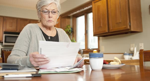 Mature Woman Looking at Household Bills