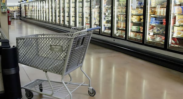 UNITED STATES - MARCH 02:  An empty shopping cart sits in an empty aisle at a Wal-Mart SuperCenter store in Grove City, Ohio Thursday, March 2, 2006. Shoppers curbed spending at U.S. retailers in February as a blast of winter weather hurt demand for spring apparel. Stores had their smallest sales gain in nine months.  (Photo by Jay Laprete/Bloomberg via Getty Images)