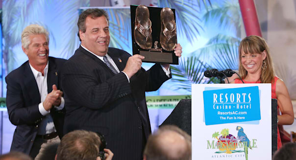 ATLANTIC CITY, NJ - MAY 23:  New Jersey Governor Chris Christie was presented with a pair of bronzed Margaritaville Flip Flops celebrating the opening and the start of summer on the shore during the ribbon cutting ceremony of the new Margaritaville and LandShark Bar & Grill at Resorts Casino Hotel on Thursday May 23, 2013 in Atlantic City New Jersey.  (Photo by Tom Briglia/FilmMagic)
