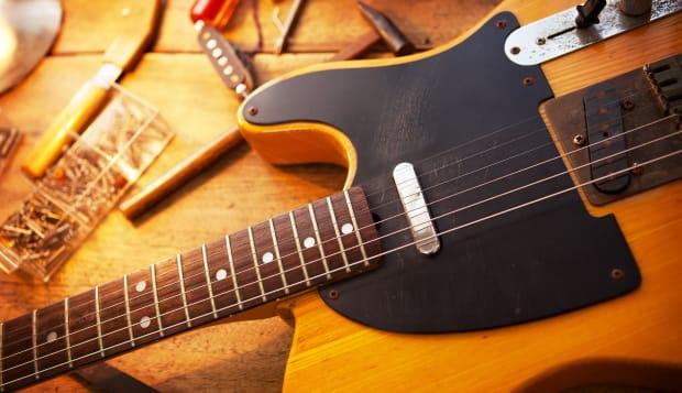 guitar on guitar repair desk....
