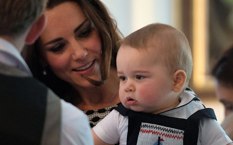 Prince George plays with other babies at first official engagement