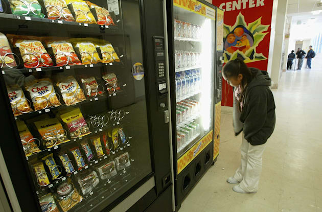 A student buys snacks from a vending machine at Mission High School April 8, 2004 in San Francisco,