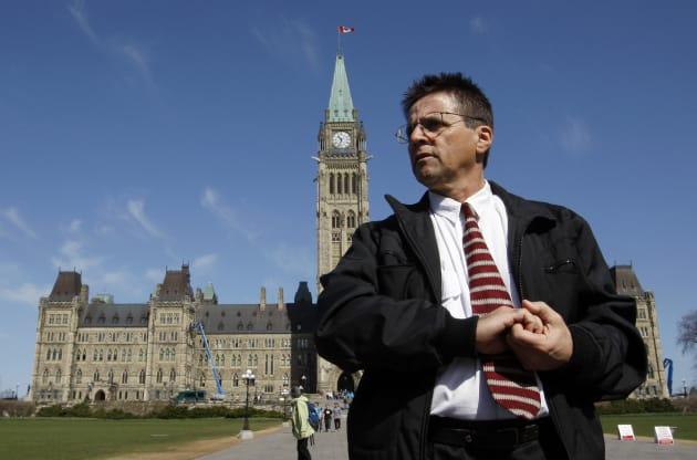 Ottawa professor Hassan Diab leaves the Parliament Hill following a news conference in Ottawa April 13,