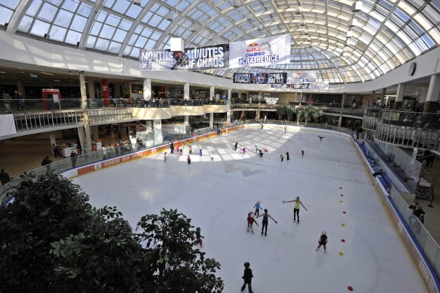 People skate at the Ice Palace skating rink at the West Edmonton
